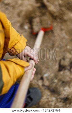 Detail Of Child In Overalls With Shovel In Action - Boy In Workwear