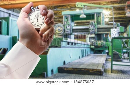 Machine Shop And Stopwatch In Male Hand