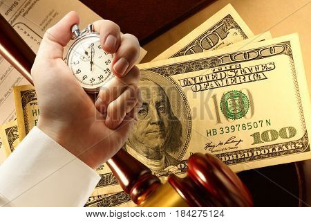 Tax Form, Gavel, Dollars And Stopwatch In Hand