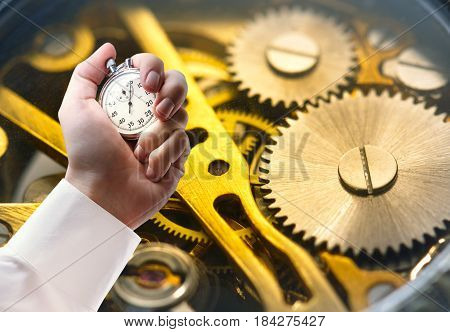 Clock Inside Mechanism And Stopwatch In Male Hand