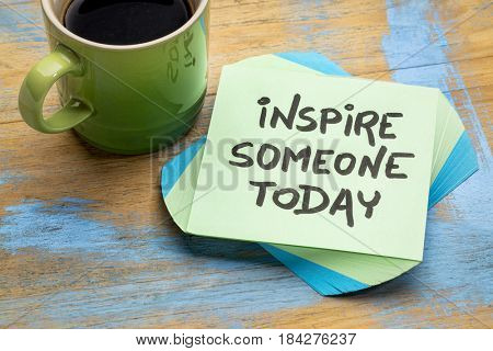 Inspire someone today - advice or  reminder on a sticky note with a cup of coffee