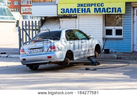 Samara Russia - April 28 2017: New tyres are mounting on the car