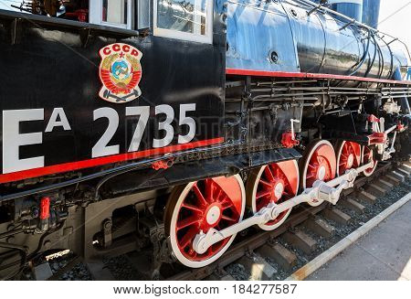 Samara Russia - April 29 2017: Russian retro steam locomotive with symbol of former state the USSR and red wheels