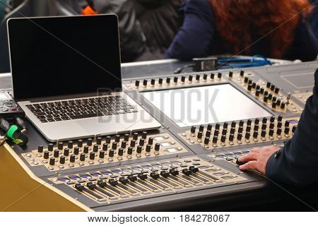 Sound mixer board at a live concert