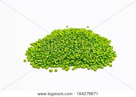 Green Plastic Pellets On A White Background. Polymeric Dye For Plastics.