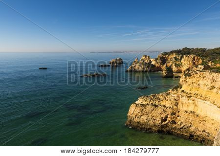 View of the scenic Ponta Joao D'Arens beach in Portimao Algarve Portugal; Concept for travel in Portugal and explore Algarve