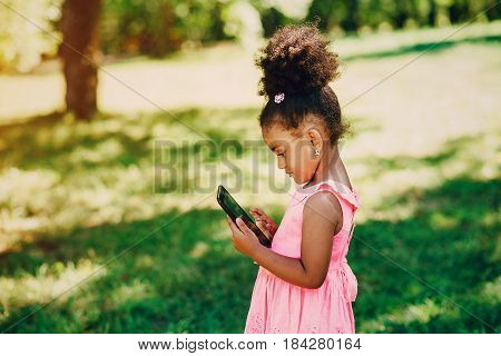 little girl walking park. uses communication. playing on the playground