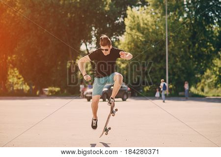 man riding a skateboard, walking park and a good time