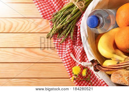 Picnic Wicker Basket With Food On Wood Table Top
