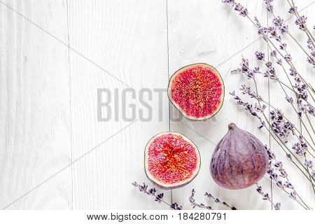 lavender flowers bouquet with cut fig mock up on white desk background top view
