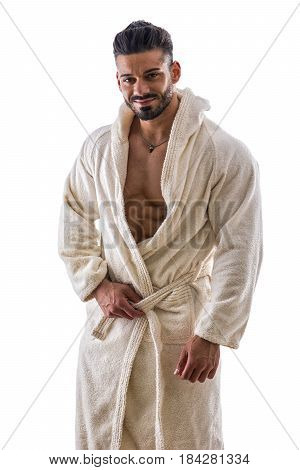 Handsome muscular male in bathrobe undressing, isolated on white background, smiling at camera