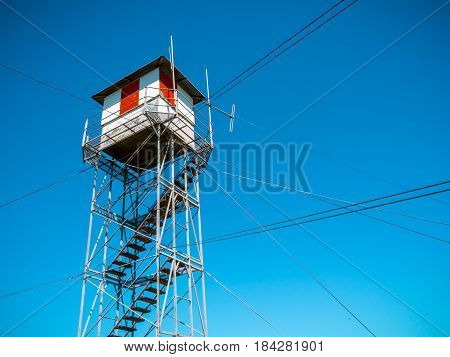 Fire Lookout Tower under a blue sky