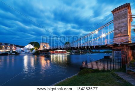 Twilight capture of the Marlow suspension bridge over the River Thames at Marlow in Buckinghamshire