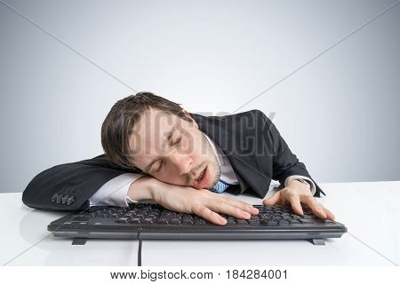 Tired Or Exhausted Overworked Businessman Is Sleeping On Keyboar