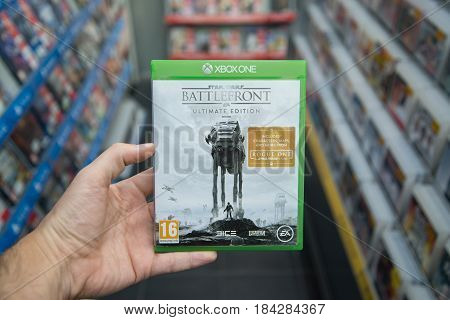 Bratislava, Slovakia, circa april 2017: Man holding Star Wars Battlefront Ultimate edition videogame on Microsoft XBOX One console in store