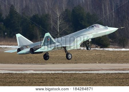ZHUKOVSKY, MOSCOW REGION, RUSSIA - MARCH 15, 2017: Sukhoi T-50 058 BLUE Russian fifth generation jet fighter taking off for a test flight at Zhukovsky - Ramenskoe airport.