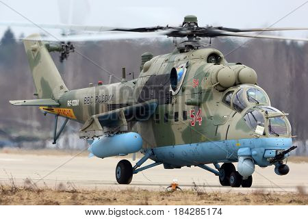 KUBINKA, MOSCOW REGION, RUSSIA - APRIL 10, 2017: Mil Mi-35M RF-13384 attack helicopter of Russian air force during Victory Day parade rehearsal at Kubinka air force base.