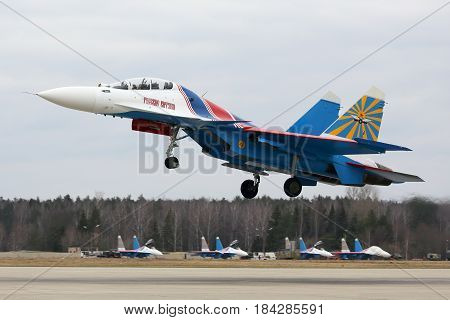 KUBINKA, MOSCOW REGION, RUSSIA - APRIL 10, 2017: Sukoi Su-30SM 32 BLUE of Russian Knights aerobatics team of Russian air force during Victory Day parade rehearsal at Kubinka air force base.