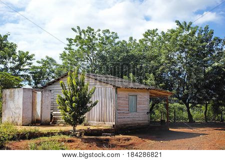 Small Wooden Cottage surrounded by trees in Vinales Valley, Cuba