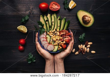 Healthy Food Concept. Hands Holding Healthy Salad With Chickpea And Vegetables. Vegan Food. Vegetari