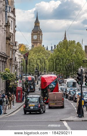 London UK - April 25 2017: Busy Whitehall street view from Trafalgar Square with Big Ben in the background.