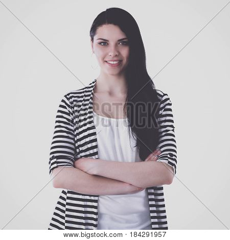 Beautiful casual young woman standing isolated against white background