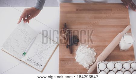 Young woman making cookies in the kitchen.
