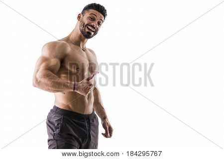 Handsome bodybuilder doing pose with funny, silly expression, looking at camera, isolated on white background