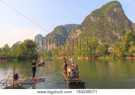 YANGSHOU CHINA - NOVEMBER 17, 2016: Unidentified people take bamboo rafting in Yulong river.