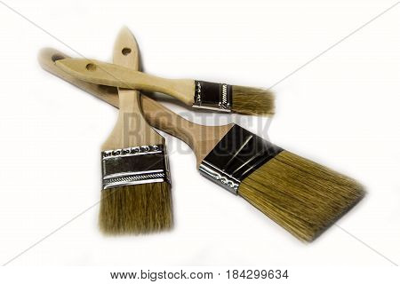 brushes, painting brushes, isolated brushes, three paint brushes, brushes with wood handles,