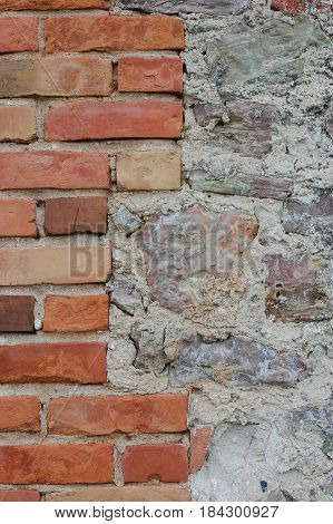 Stone wall background closeup vertical plastered grunge red brick stonewall beige limestone pattern old aged weathered beige lime plaster texture natural grungy textured reddish vintage rough rustic bricks birckwork