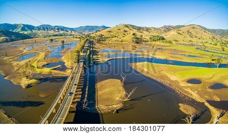 Aerial Panorama Landscape Of Murray Valley Highway And Bridge Over Lake Hume, Victoria, Australia