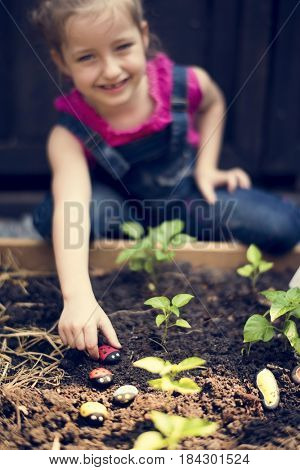 Little Girl Learning Environment at Vegetable Farm