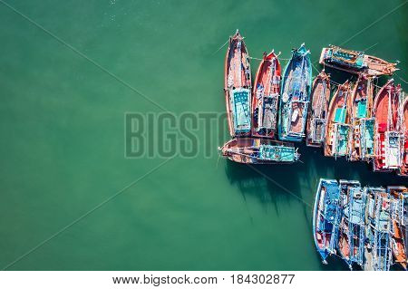 The big fishing boats standing at the sea in Phuket Thailand