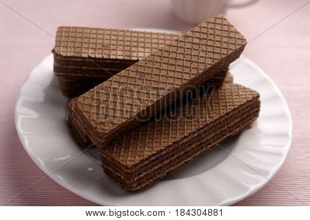 Chocolate wafers on a plate closeup