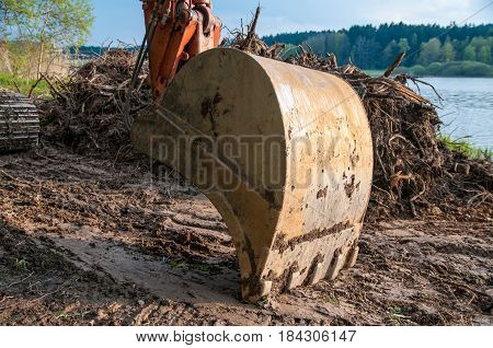 Excavators dredge and clean up a river before the winter rains. Excavator dredge a river
