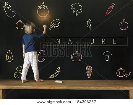 Little girl writing on blackboard about vegetable healthy food icon