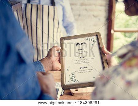 People is selecting order from menu