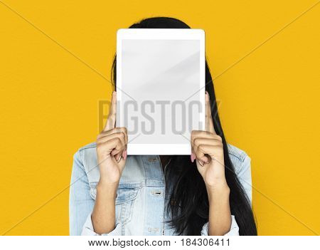 Woman using digital tablet covering her face