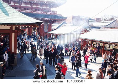 Tokyo, Japan - Feb 19, 2017 - People going to Temple Sensoji in Tokyo, Japan. The sensoji temple in asakusa area is the oldest temple in tokyo.