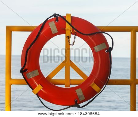 Safety equipment Life buoy or rescue buoy stand by sea to rescue people from drowning man in sea off shore.
