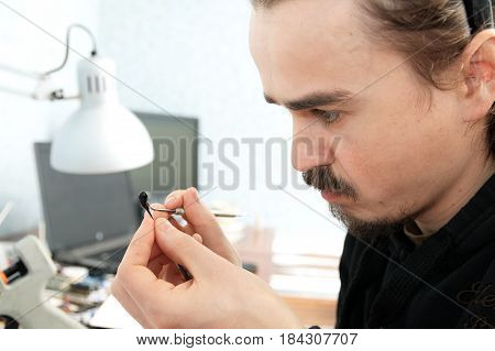 sculptor artist sculpting handmade miniature plastic toy house decoration craftsmanship hobby decor creation process
