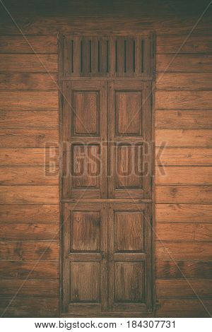 Old Grunge Wood Simple Door And Wooden Wall, Vintage Tone With Vignetting.