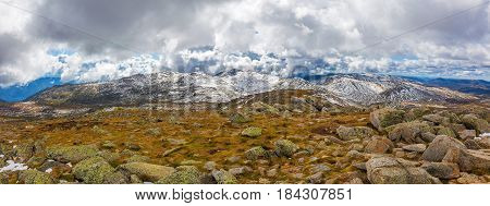 Panoramic Landscape Of Snow Covered Peaks Of Australian Alps Under Beautiful Clouds. New South Wales