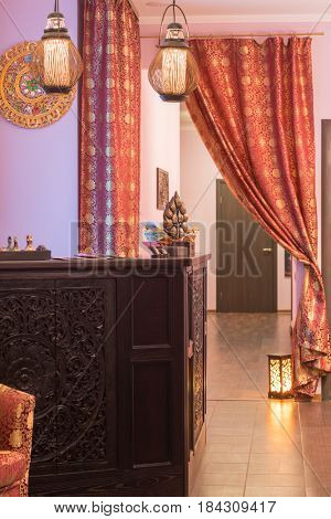 Empty beautiful wooden reception in thai day spa with asian decoration