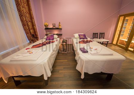 Empty room with two beds for thai massage and asian decoration