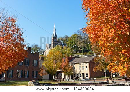 Harpers Ferry historic town in autumn West Virginia USA. The town in magnificent fall colors with historic site and city church.