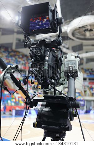 Professional modern camera at basketball game in stadium, shallow dof