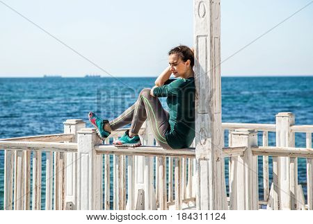 Sporty Girl On The Pier Doing Exercises To Do Fitness