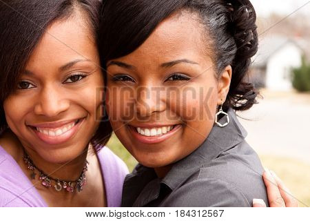 Happy African American friends laughing and smiling.